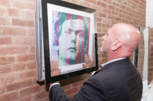 George Geannakakes, regional sales engineer, Commercial Air Conditioning North East, LG Electronics USA, demonstrates the customizability of the LG Art Cool Gallery with an original piece of art created on-site at the LG and Dwell Design Week kick-off event at the LG Kitchen at Union Square on Monday, September 28, 2015, in New York. (Photo by Zack Seckler for LG Electronics) (PRNewsFoto/LG Electronics USA)